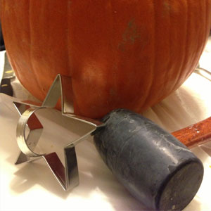 pumpkin carving tool: use mallet with cookie cutters to cut pumpkin