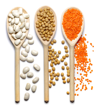 spoons of beans, peas, red lentils