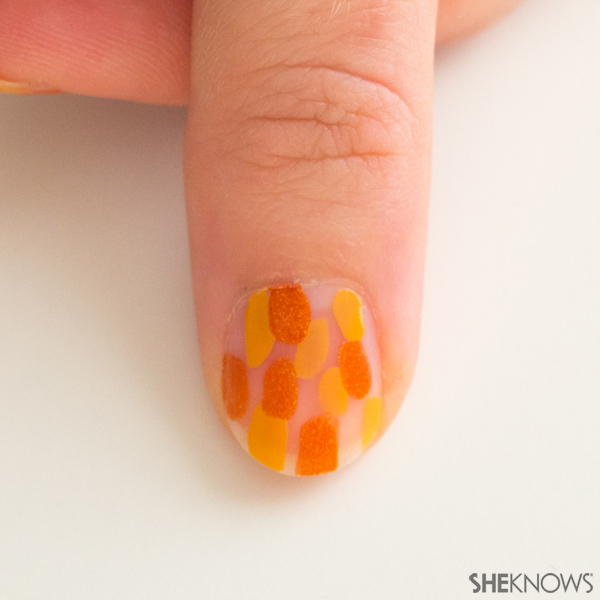 Abstract fall leaves nail design | Sheknows.com -- orange spots