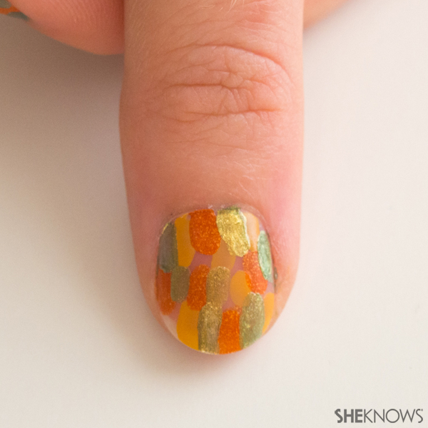 Abstract fall leaves nail design | Sheknows.com -- green spots
