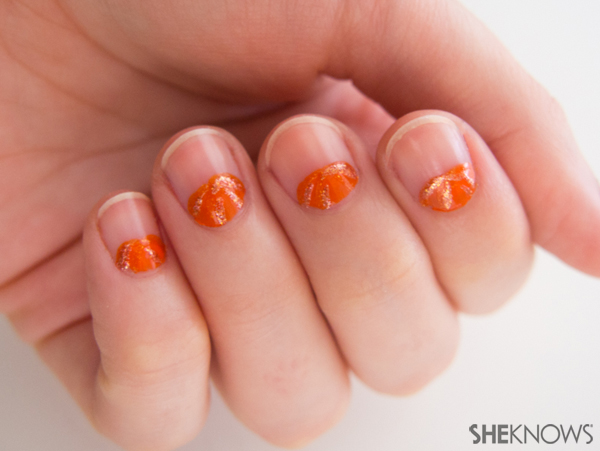 Peeking pumpkin nail design | Sheknows.com -- decorating