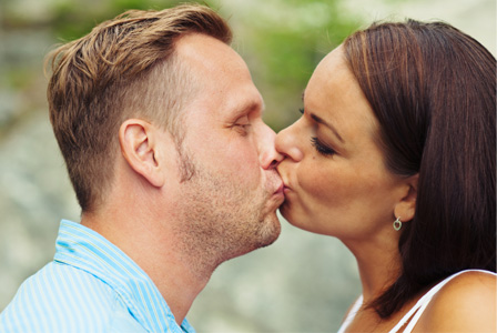Couple kissing awkwardly