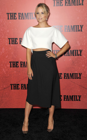 Dianna Agron wearing a black and white dress to premiere of The Family