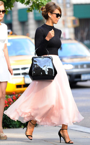 Jessica Alba wearing black shirt and pink skirt