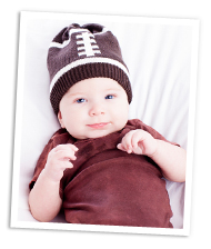 Baby boy wearing football hat