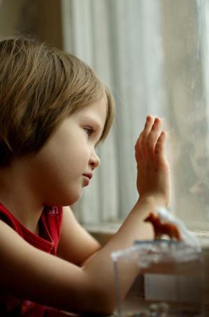 Sad girl lookin out window