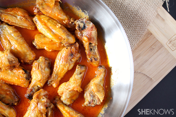 Like your wings on the spicy side? These spicy-sweet garlicky wings ...