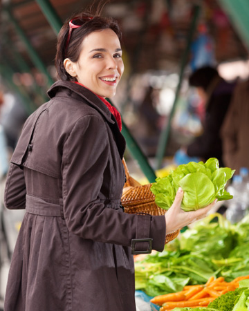 Woman shopping for fall vegetables