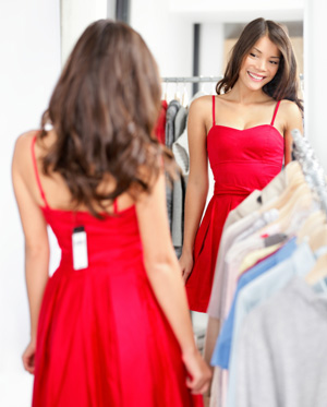 Woman wearing dress with price tag