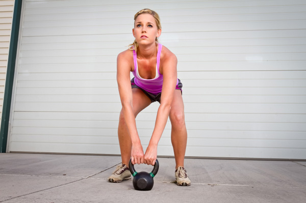 Woman with kettlebells