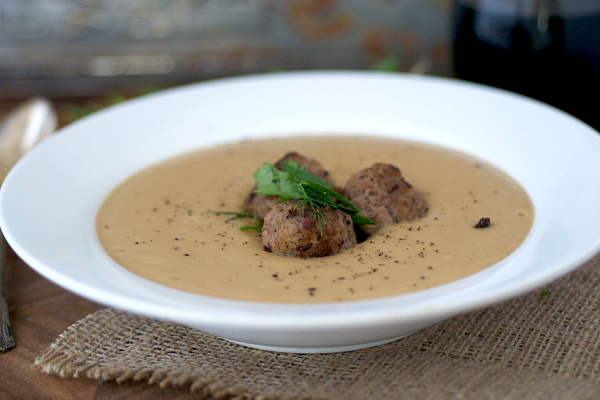 Garlic and parsnip soup with meatballs