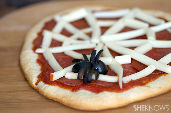Homemade spider web pizza