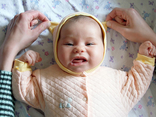 Baby photo fails - Don't touch the ears!