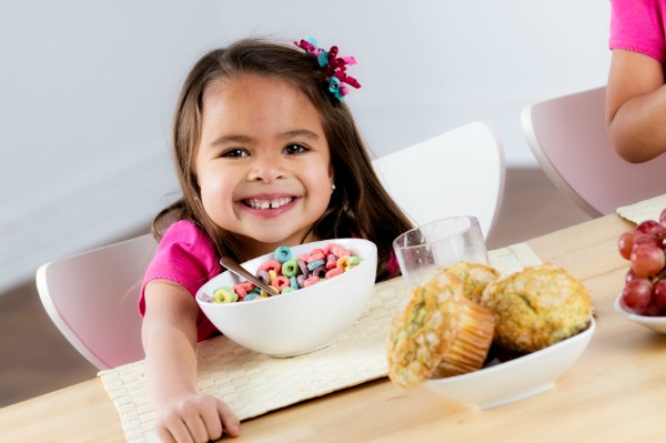 Girl eating colorful cereal