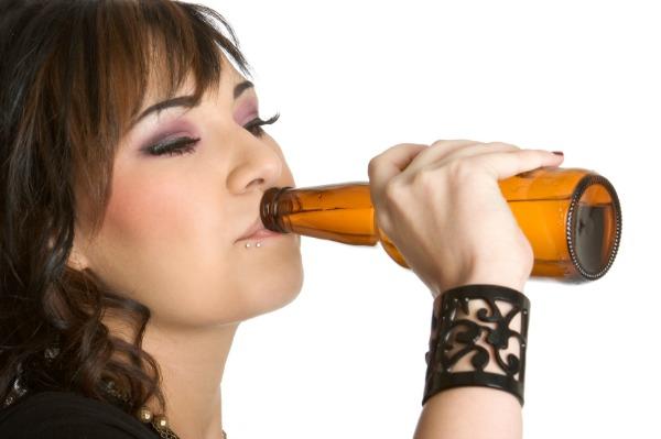 Teen girl drinking beer