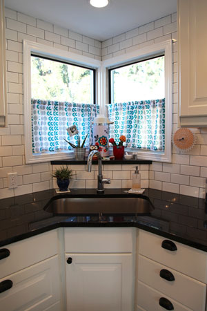 Mollys kitchen subway tile and black granite counters