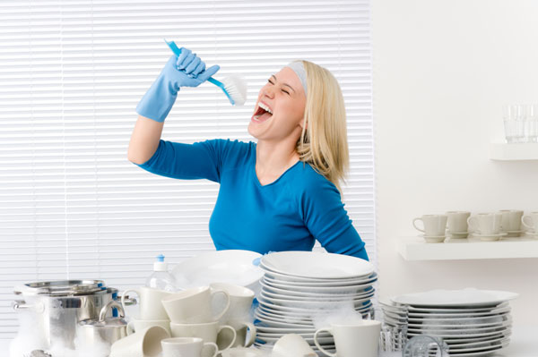 Woman singing into scrub brush