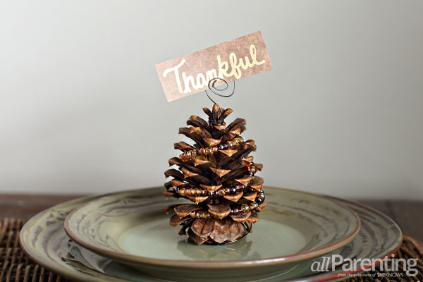 Beaded pine cone place card holder