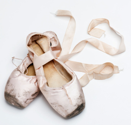 old and worn ballet shoes
