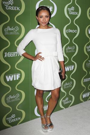 Kat Graham wearing a white dress