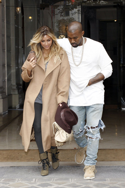 Kim Kardashian's camel coat and lace-up booties