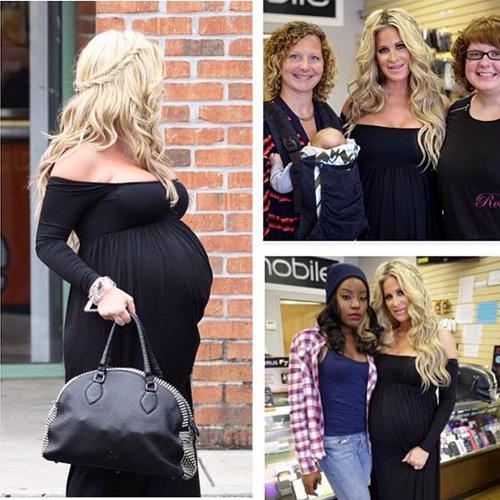 Pregnant Kim Zolciak in a black maxi dress