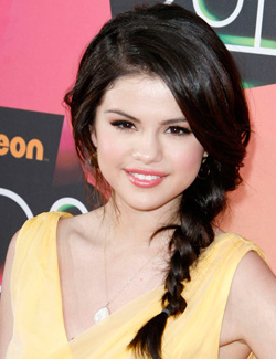 Selena Gomez wearing a side braid
