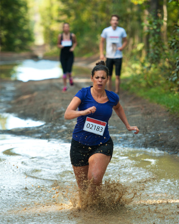 Woman doing mud run