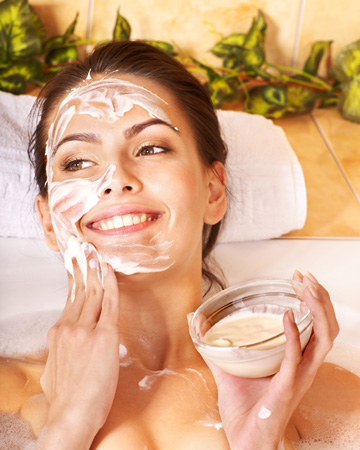 Woman having facial in tub