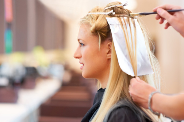 Woman getting her hair highlighted