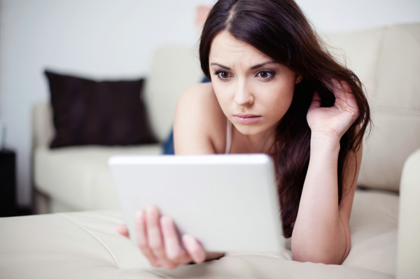 Upset woman looking at iPad