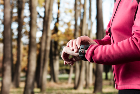 Woman running with heart rate monitor