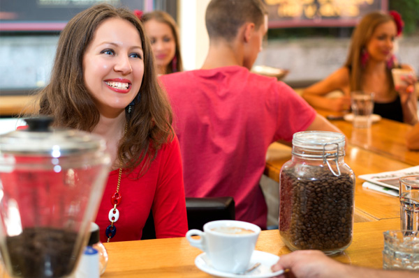Woman talking to barista