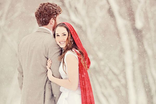 Bride and groom standing in winter wonderland | Sheknows.ca