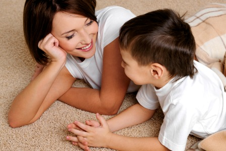 Young boy talking to mom