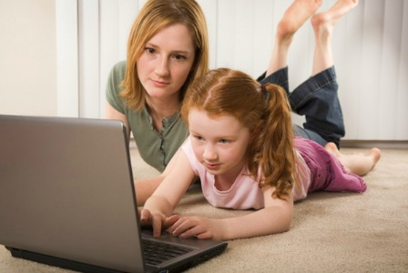 Little girl with mom online