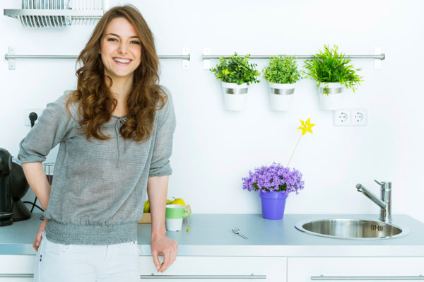 Happy woman standing in kitchen