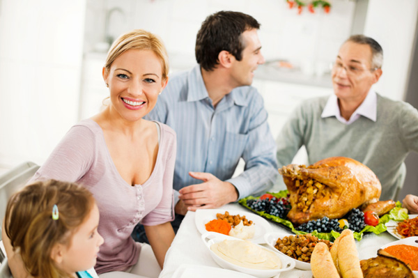 Woman celebrating Thankgiving with family