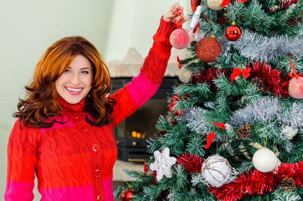 Woman decorating tree