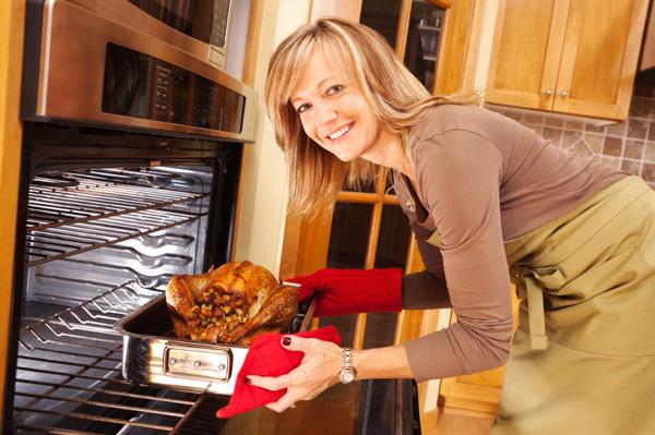 Woman preparing Thanksgiving turkey