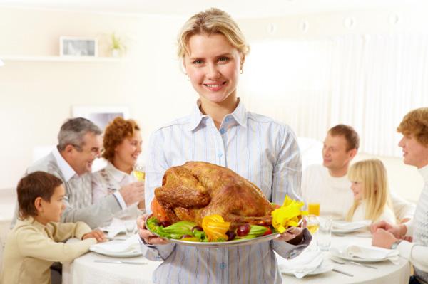 Woman serving family thanksgiving dinner