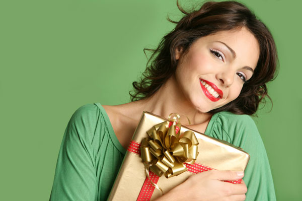 Woman holding holiday present