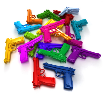 pile of colorful toy guns