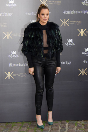 Khloe Kardashian wearing feathered jacket