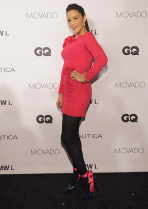 Paula Patton wearing pink shirt over leggings to GQ event