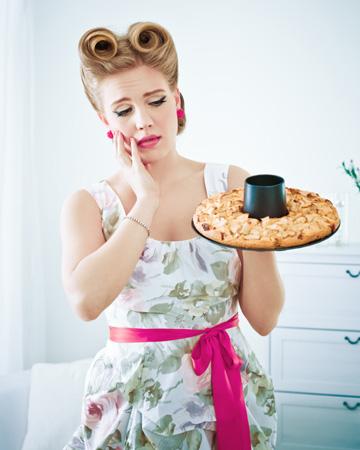 Sad woman with pie
