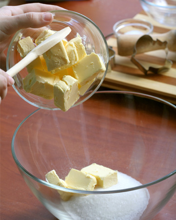 Woman baking with butter