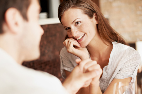 Woman smiling at date