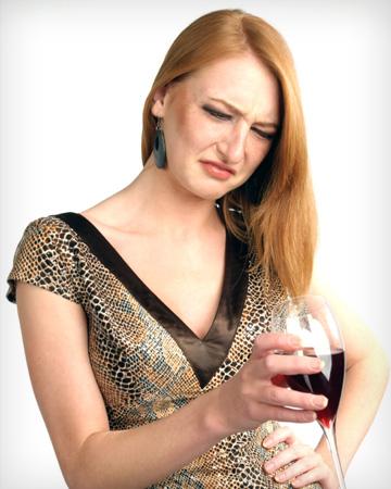 Woman drinking bad wine