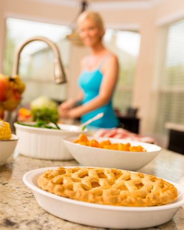 Woman preparing gluten-free Thanksgiving meal